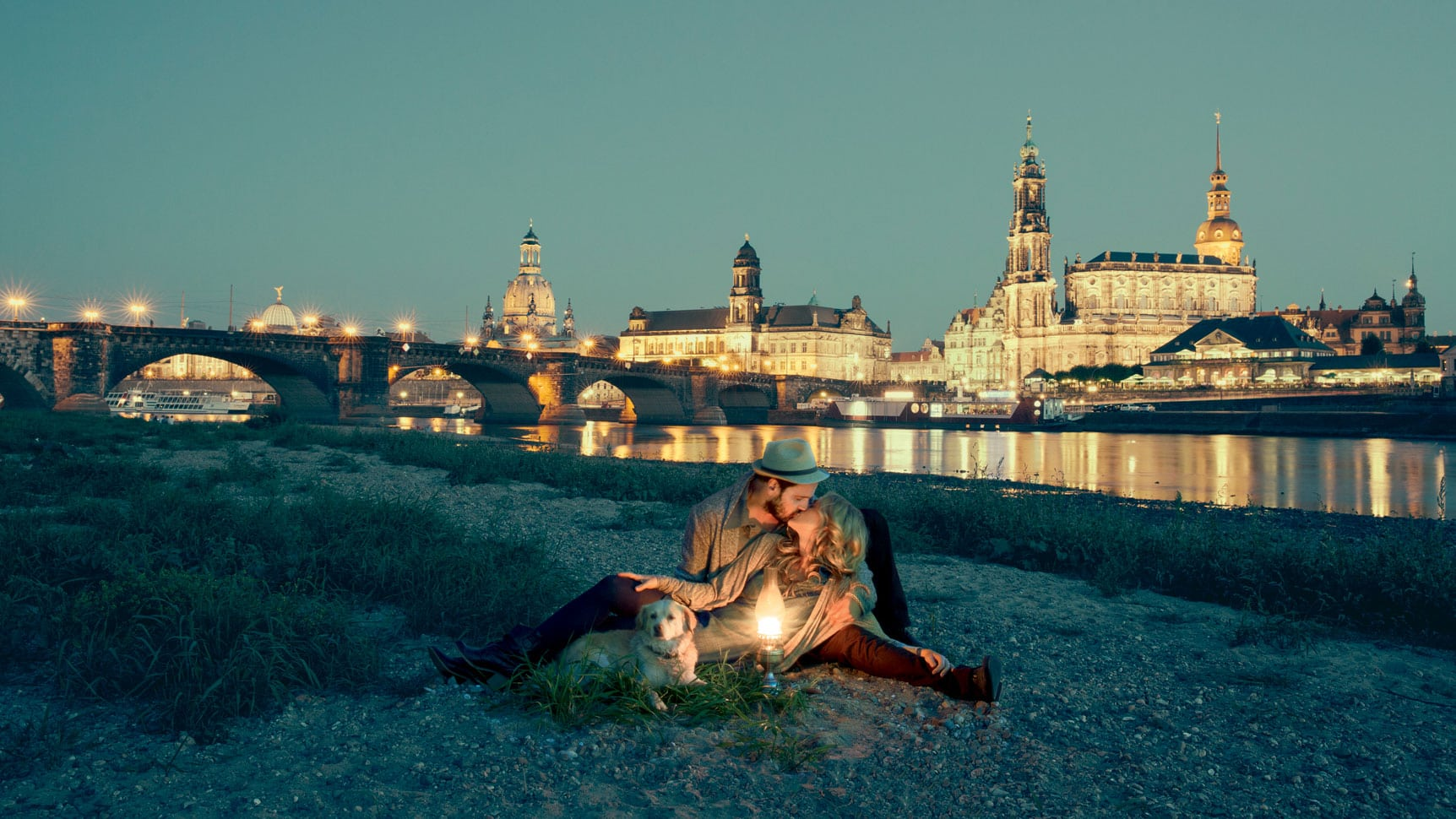 A couple with dog in front of the skyline of Dresden